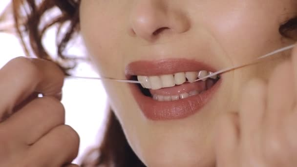 Close up of mouth and dental floss