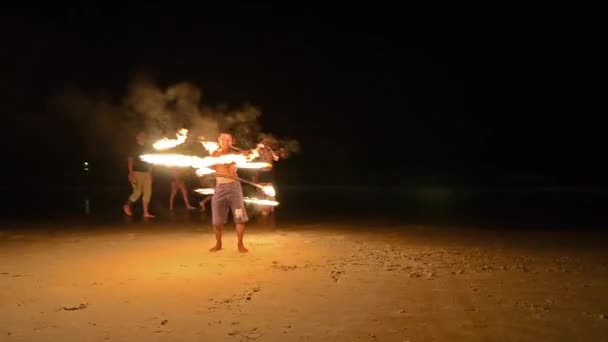 Thailand, Phuket, young juggler on the beach at night
