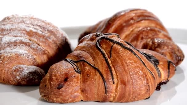 Croissants rotating over white background. Breakfast.