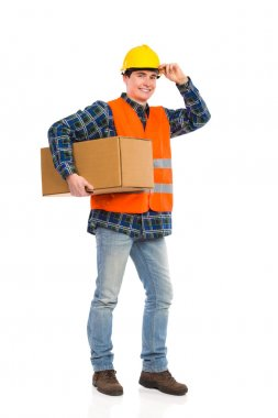 Construction worker holds carton box under the arm.