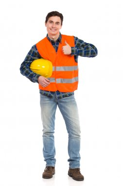 Engineer wearing reflective clothing and showing thumb up.