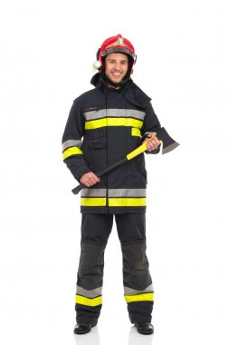 Firefighter posing with axe.