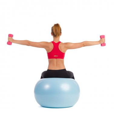 Female Exercise On Fitness Ball With Hand Weights