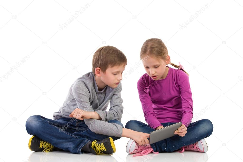 Two kid using tablet