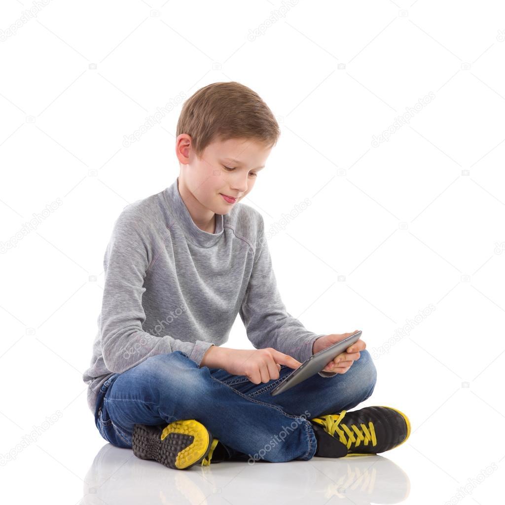 Boy using a digital tablet.