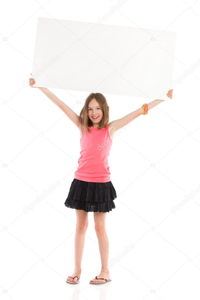 Smiling girl holding blank placard over her head