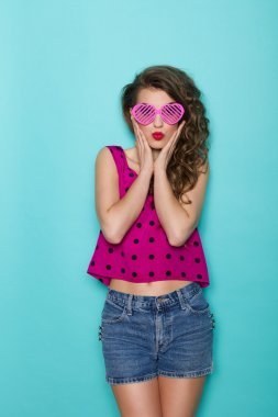 Surprised girl in pink sunglasses