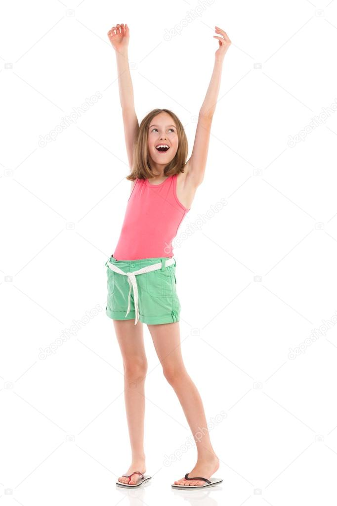 Shouting girl with arms raised