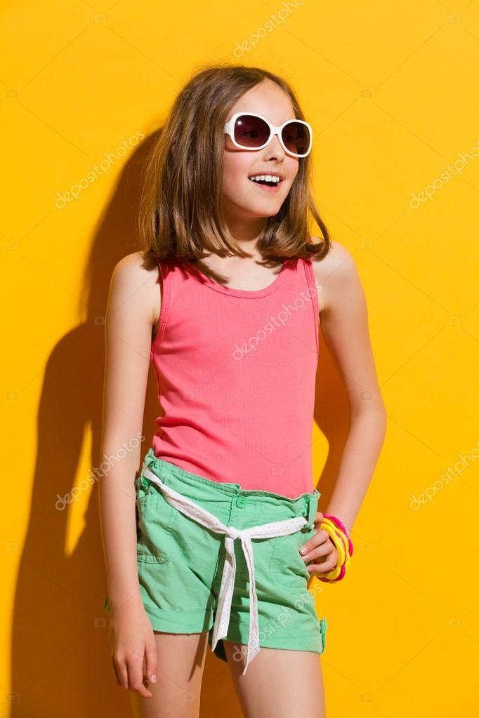 Little girl on yellow background