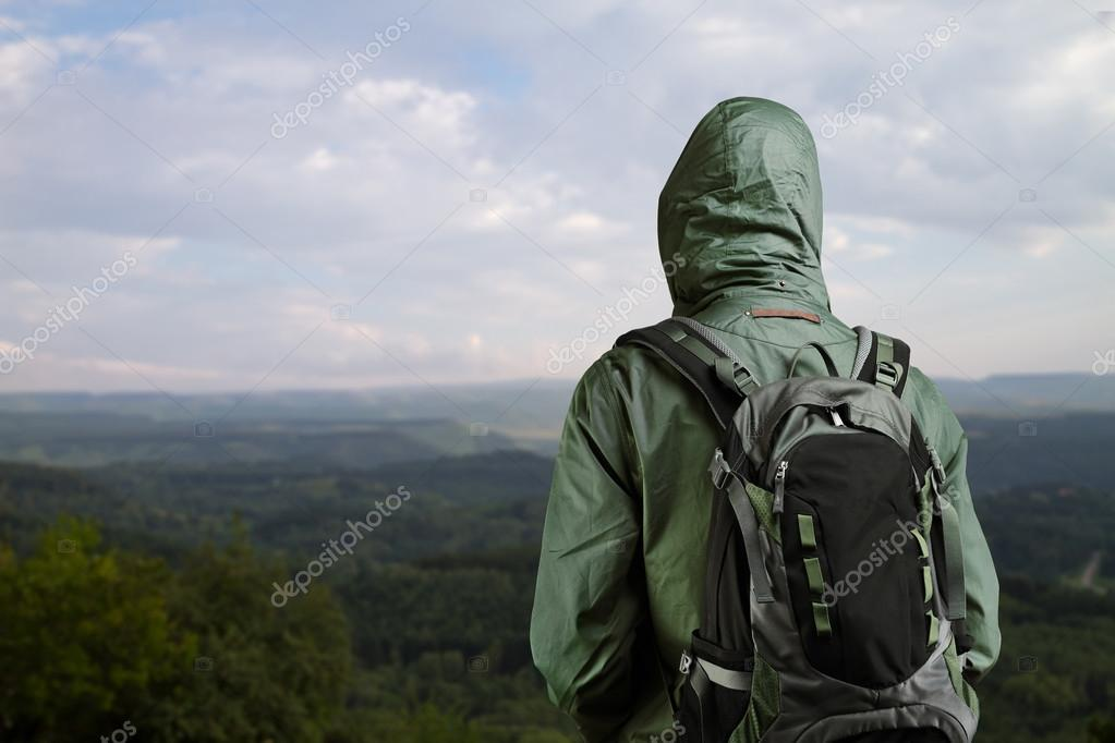 Hiker man enjoying view at nature with backpack.