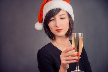 Young woman with beverage champagne