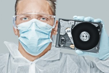 Technician holds the hard disk