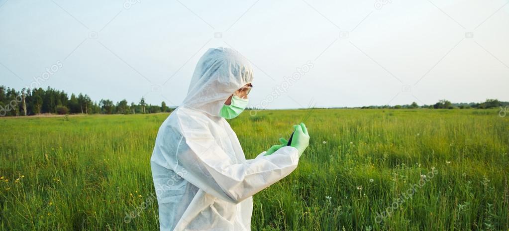 Biotechnology scientist on summer field