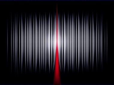 Black curtains illuminated by a spotlight