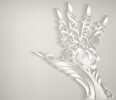 Stylized palm. Hand carved white patterned paper.