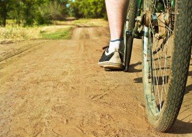 Closeup of  retro bike on dirt track.