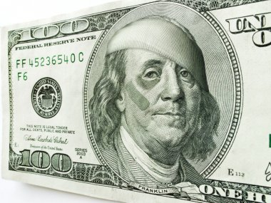 Ben Franklin with black eye and bandages on one hundred dollar bill illustrates many economic concepts and ideas.