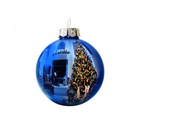 Shiney Blue Ornament Reflects Christmas Tree Holiday Decorated Living Room