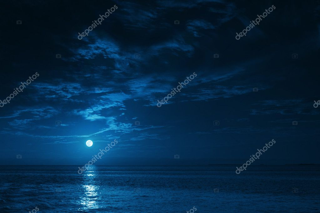 Beautiful Midnight Ocean View With Moonrise And Calm Waves