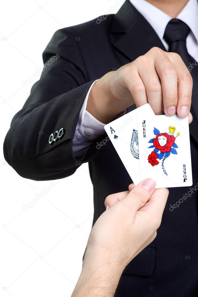 business man picks card joker in isolated — Stock Photo © maniaroom ...