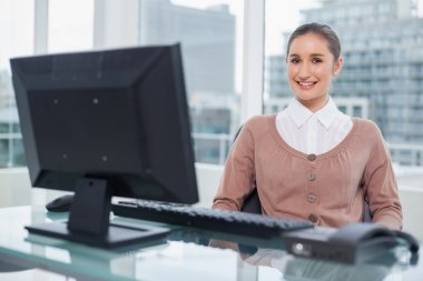 Smiling businesswoman sitting on swivel chair
