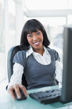 Relaxed businesswoman working on computer
