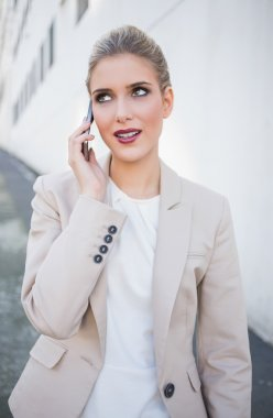 Smiling attractive businesswoman on the phone