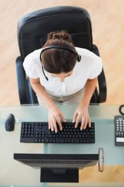 Call center agent typing while on a call