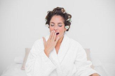 Yawning natural brunette closing her eyes