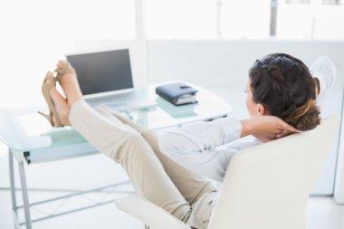 Relaxed stylish brunette businesswoman enjoying her break