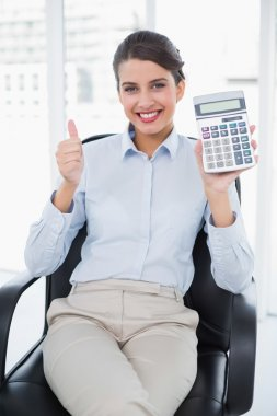 Businesswoman showing her calculator