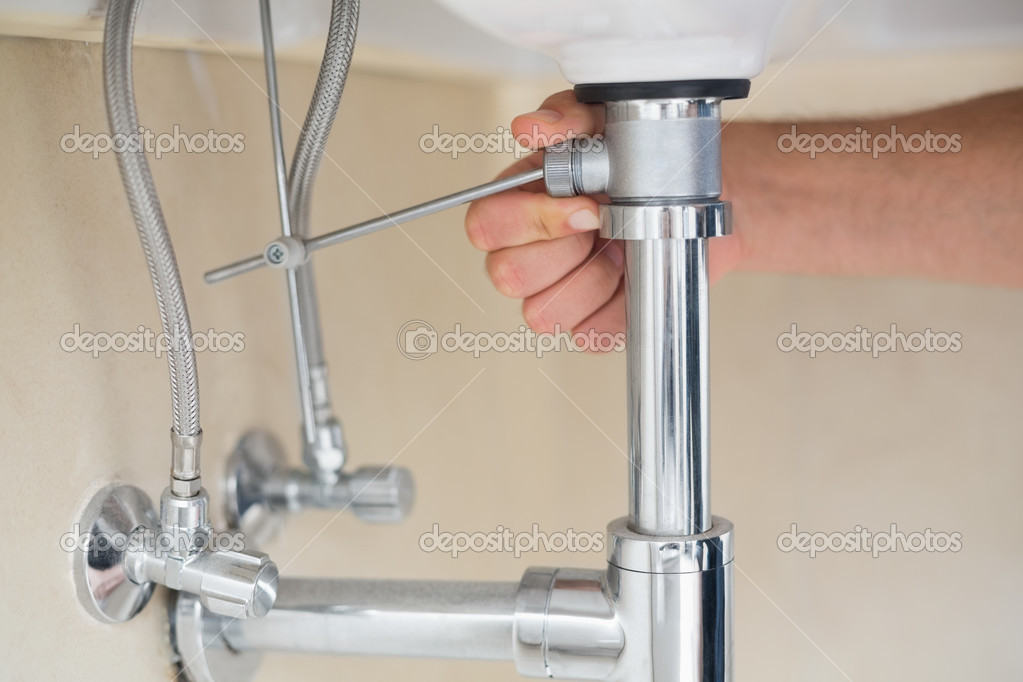 Afvoer Wastafel Monteren : Extreme close up van een loodgieter hand en wastafel afvoer
