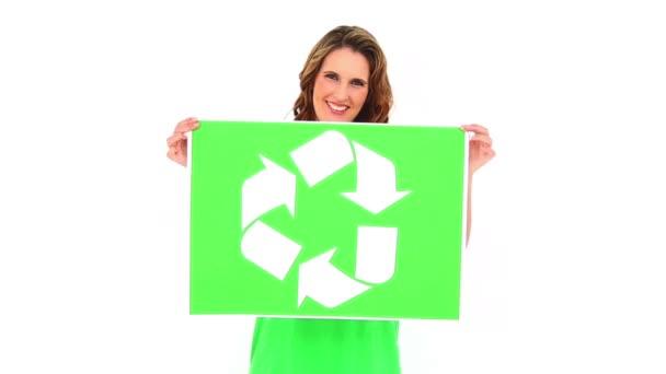 Smiling environmental activist showing poster