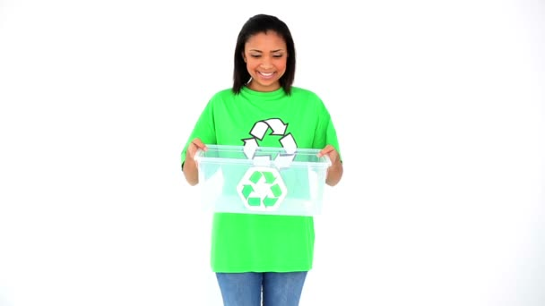 Friendly smiling environmental activist showing a basket with the recycling symbol on it
