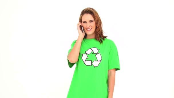 Smiling environmental activist talking on mobile phone