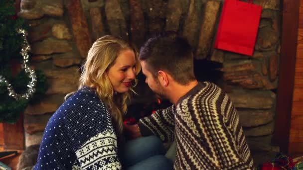 cute couple celebrating christmas together in front the fire stock video