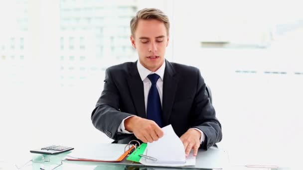 Desperate attractive businessman working sitting at his desk