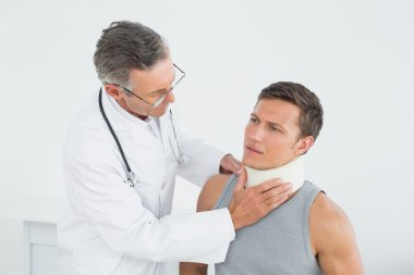 Doctor listening to patient with concentration