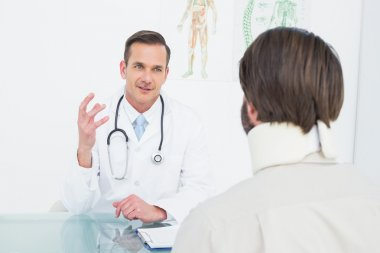 Doctor in communication with patient at medical office