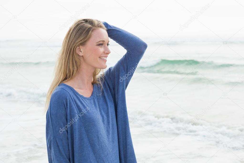 Side view of a smiling casual woman at beach