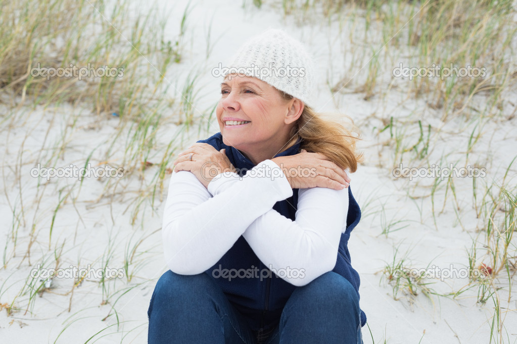 Senior woman looking away at beach