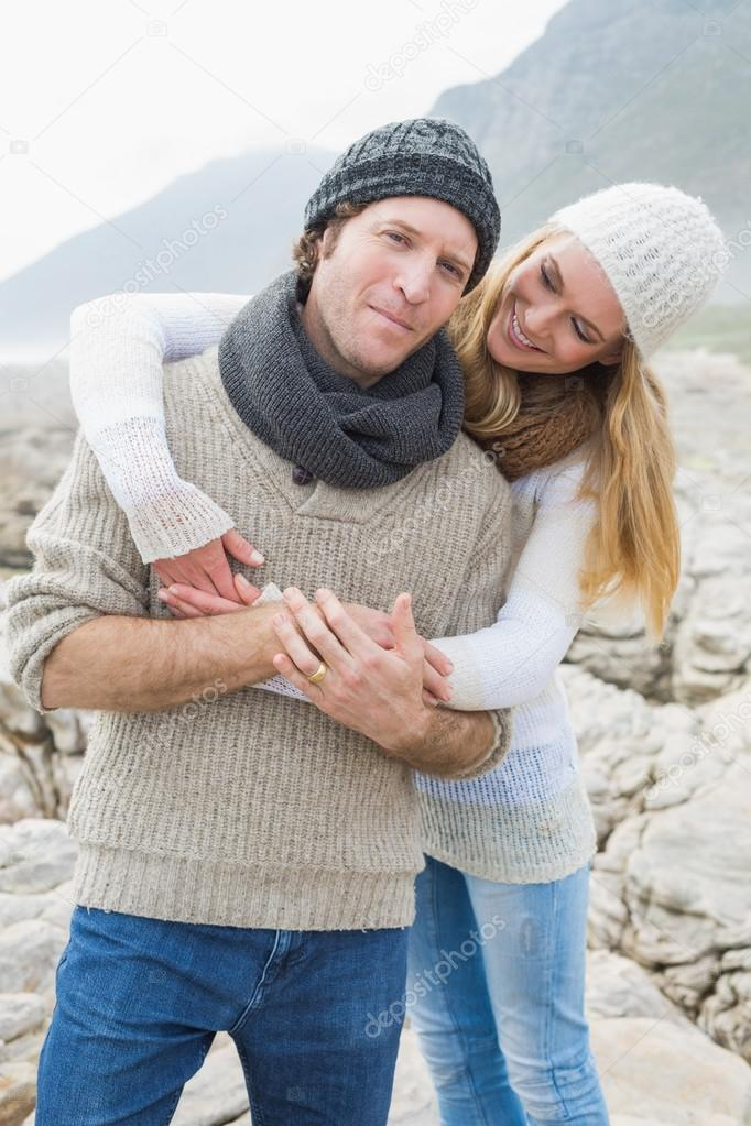 Happy romantic couple together on rocky landscape