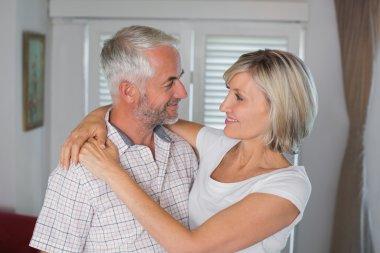 Smiling woman embracing mature man