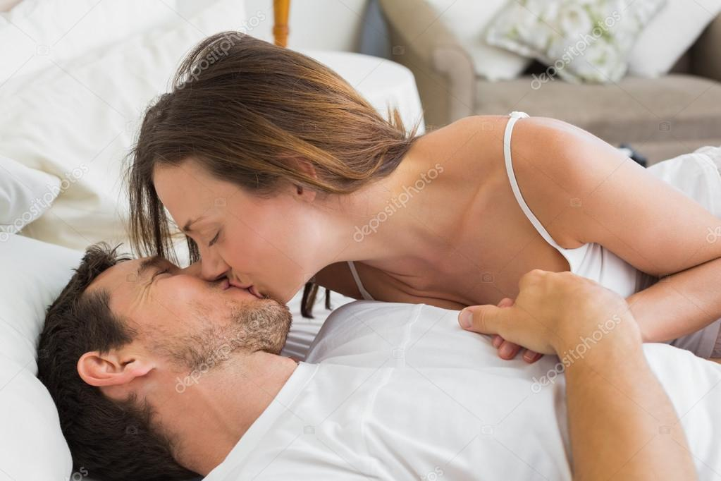 Relaxed Couple Kissing In Bed U2014 Stock Photo