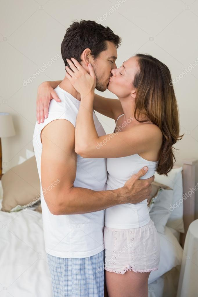 Loving Young Couple Kissing At Home Stock Photo C Lightwavemedia