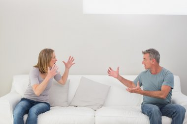 Unhappy couple having an argument in the living room at home stock vector