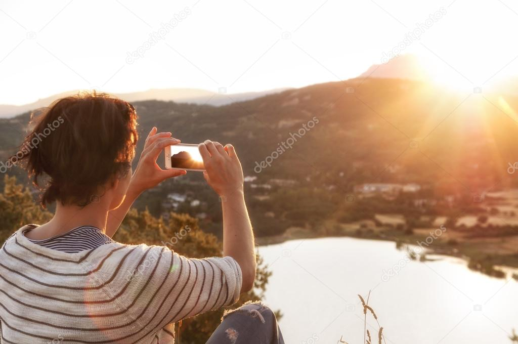 Woman taking photo with mobile