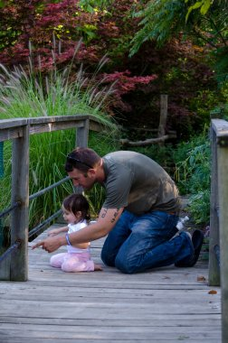 Father daughter discovering nature