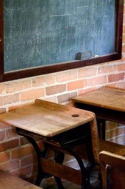Desks and black board in an old school house