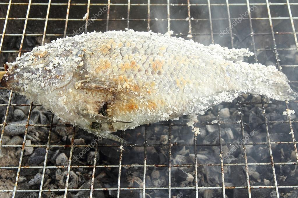 Grilled fish on roaster